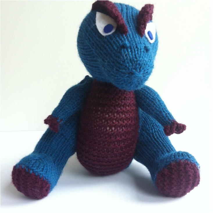 knitted T Rex, sitting
