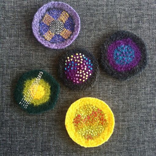 colourful embroidered felted wool discs